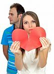 attractive-young-girl-holding-broken-paper-red-valentine-heart-100112133.jpg